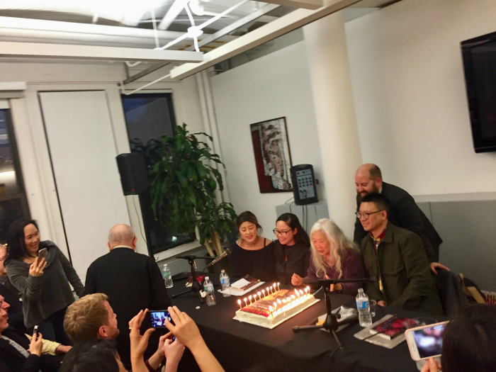 Maxine Hong Kingston blows out candles
